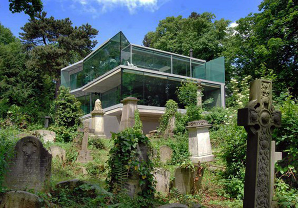 unusual houses - Transparent house in the cemetery